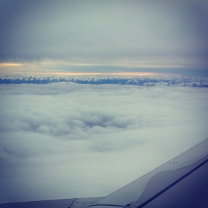 In the clouds:  snow-capped mountains on the South Island of New Zealand