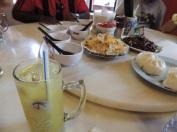 Lime juice,pow (pork bun) and fried egg yoke noodle