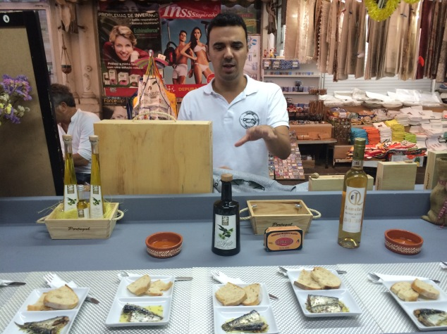 Andre demonstrating the sardines at Bolhão Wine House