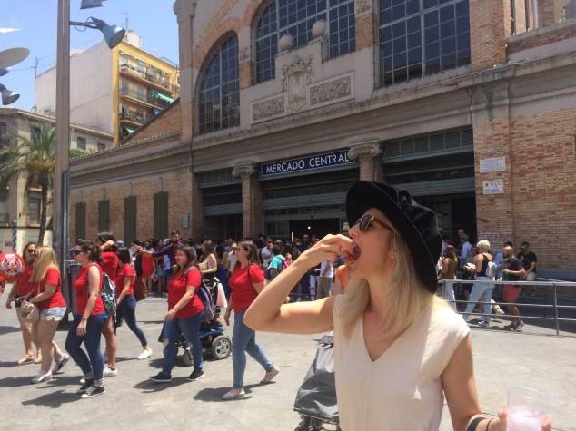 Devouring Jamon in Mercado Central in Cambridge Graduation (Dr!) hat!