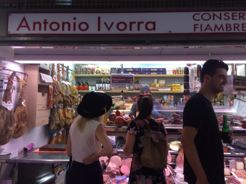 Choosing our Jamon platter in Mercado Central