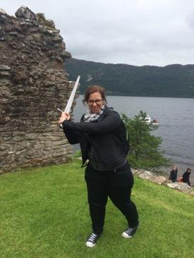 Anna sword wielding at Urquhart Castle