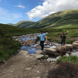 Rock jumping the Fairy Pools, Isle of Skye