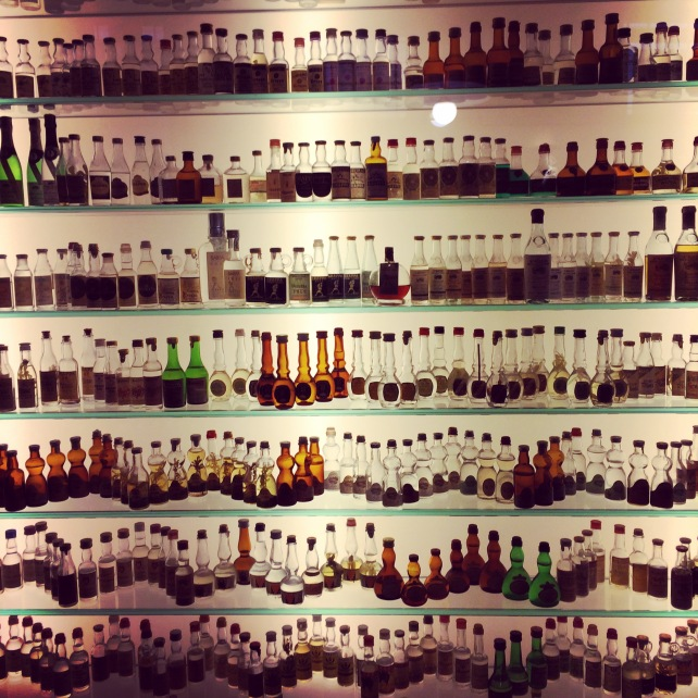 Collection of mini grappa bottles at Poli Museum