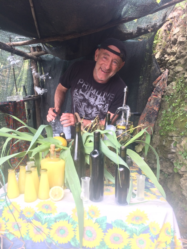 Local selling Lemoncello in Monterosso, Cinque Terre, Italy